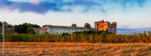 Fotobehang Freesurf Medieval castles of Italy - Castello di Santa Severa on the beach over sunrise.
