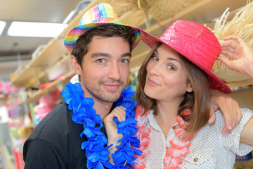 Couple in straw hats and feather boas