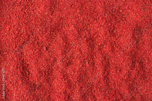 Fotobehang Hot chili peppers hot chili pepper powder spice as a background, natural seasoning texture