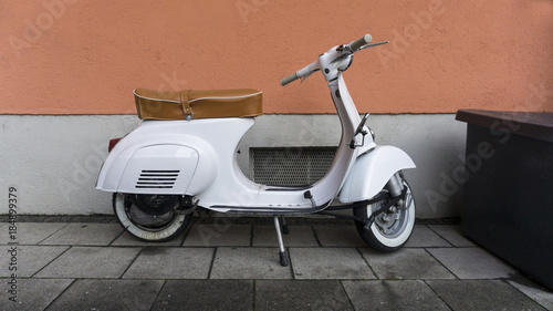 Foto op Canvas Scooter White Italian scooter parked in Munich city center