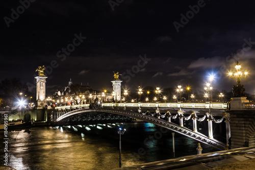 Fotobehang Parijs Gorgeous night view of Alexandre III bridge in Paris, France
