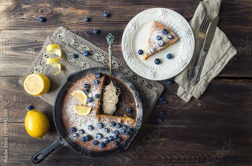 Poster Homemade lemon pie in iron skillet