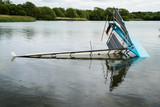 Capsized dinghy on Hornsea Mere, Yorkshire, UK. - 184943782