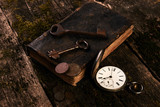 Antique pocket watch, old book with ancient copper coins - 184943933