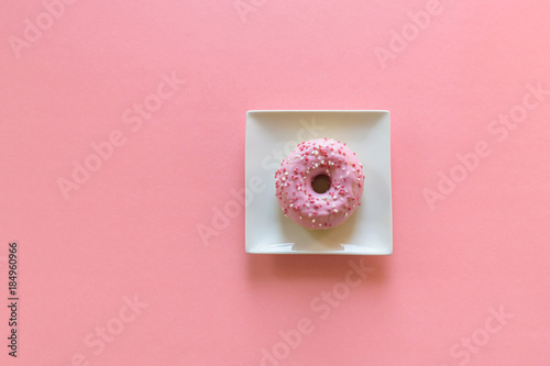 Pink doughnut on pink background with space for copy - 184960966