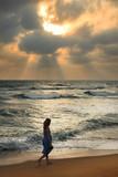 Girl on a beach on sunset - 184984745