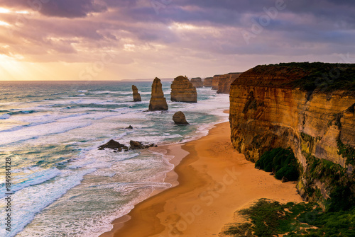 Sunset over Twelves Apostles in Great Ocean Road, Victoria, Australia. The Twelve Apostles is a collection of limestone stacks off the shore of the Port Campbell National Park.