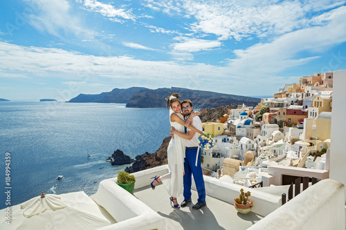 Beautiful young couple on sea background