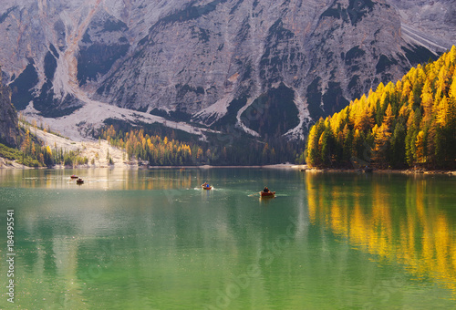 Foto op Canvas Lavendel Amazing view of Braies Lake - Lago di Braies - with autumn forest and mountains reflected in surface lake water, Dolomites, Italy, Europe