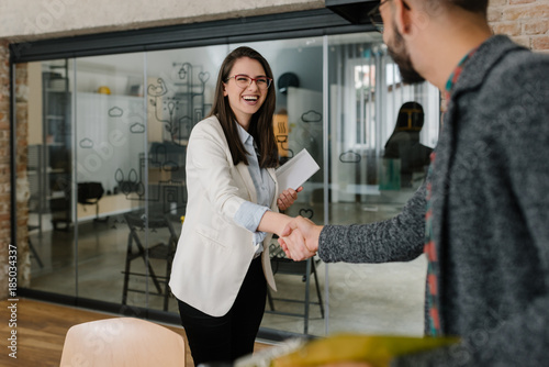 Foto Murales Smiling plainly and firmly handshaking with human resource manager