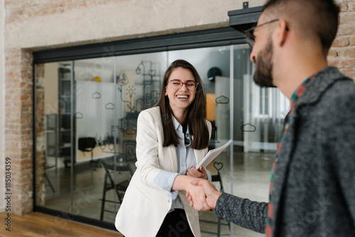 Foto Murales Handshaking and smiling candidly at a job interview