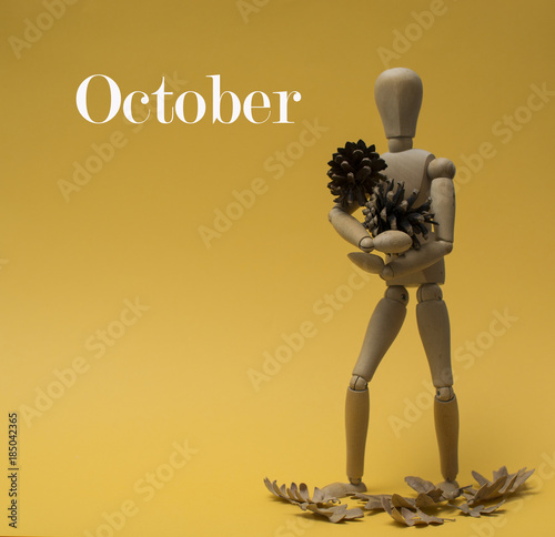 october month for calendar doll with pinecone and fallen leafs autumn in orange Poster