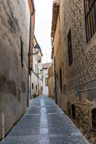 Poster Smal steegje The old city of Segovia that contains a multitude of historic buildings both civil and religious