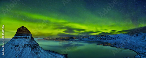 Aerial view of Kirkjufell mountain with beautiful aurora borealis in winter, Iceland. - 185048390
