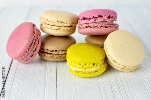 Fotobehang Macarons Colorful macarons on a white surface