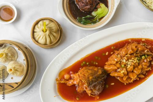 Fotobehang Shanghai Traditional Shanghai food including dumplings, stewed meatball and mandarin fish