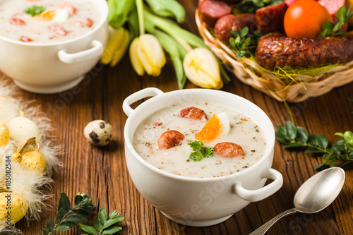 Traditional Polish white borsch with Easter decoration - 185082584