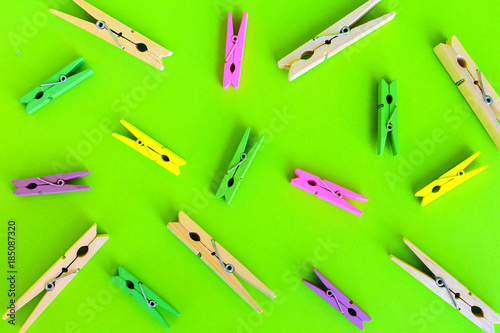 colorful wood clothes pin, paper clip on green background - 185087320