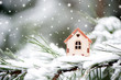 Christmas toy house on a natural natural background of a real fir in the snow, toned. Concept of winter, Christmas, new year