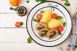 Roll of turkey minced meat with spinach and red sweet pepper with garnish of mashed potatoes - 185100508