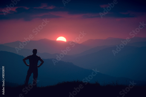Foto op Canvas Crimson Silhouette of human standing on a hill