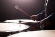 Drum sticks striking in timpani in dark tones