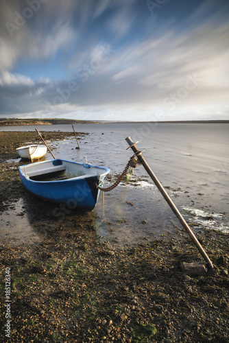 Beautiful vibrant sunset landscape image of boats moored in Fleet Lagoon in Dors Poster