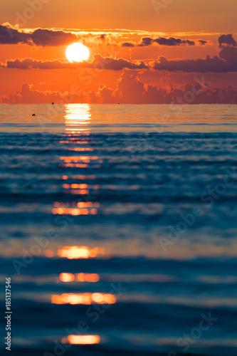 orange sunset on sea, vertical