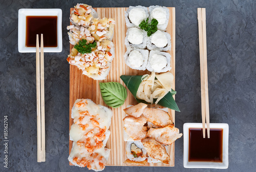 Foto op Canvas Sushi bar set of real classic Japanese sushi. on a wooden surface