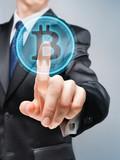 Businessman pushing bitcoin button