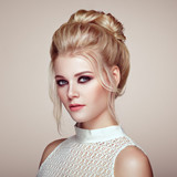 Blonde Girl with Elegant and shiny Hairstyle. Beautiful Model Woman with Curly Hairstyle. Care and Beauty Hair products. Perfect Make-Up - 185211107