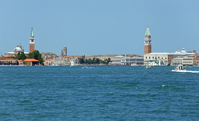 cityscape View of the island of VENICE in Italy with the ancient palaces and bell towers from the water bus