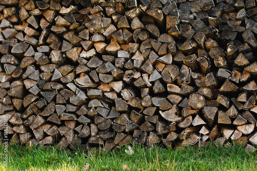 Foto op Aluminium Brandhout textuur ends of logs wooden background. toning. wood in the stack.