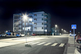 modern city street with pedestrian crossing at night