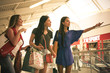 Young women at shopping moll. Close up.