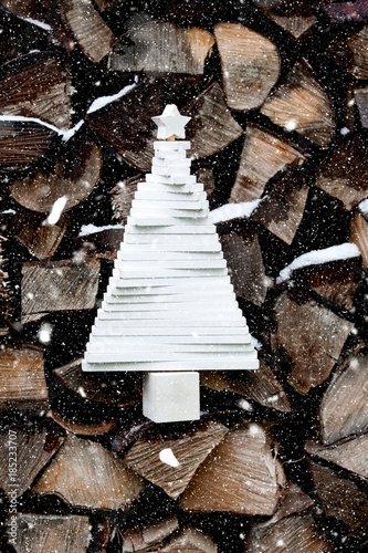 Foto op Aluminium Brandhout textuur abstract white wooden christmas tree on firewood background - rustic holidays