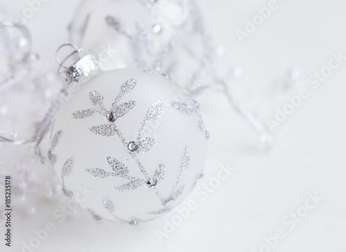 Festive silver glass ball with glitter ornament,Christmas tree decoration closeup