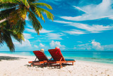 Two beach chairs on tropical vacation - 185249331