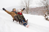 Grandfather and small girl sledging on a winter day. - 185262376