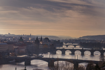 Elevated view of Prague cityscape at sunset as seen from Letna Park in black and white