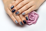 Delicate gray blue manicure with drops and silver on long square nails with rose in hand