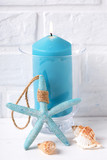 Blue burning candle, shells  and sea star - 185320123