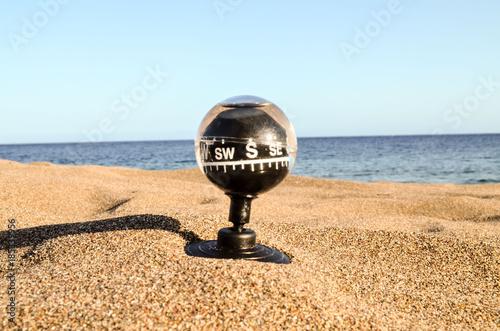 Compass on the Sand Beach - 185339956