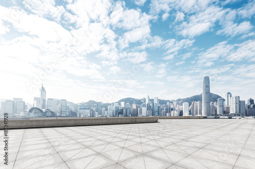 Foto Murales empty marble floor with cityscape of modern city