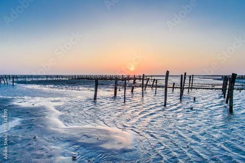Staande foto Shanghai Seaside intertidal zone with beautiful sunset in Wangong Changhua