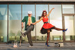 Woman teaches the old man to dance, the pensioner repeats the movements of the dance.