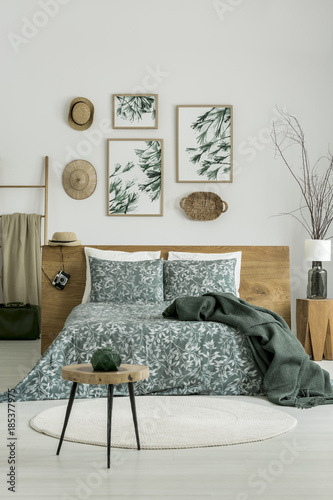 Posters in bright green bedroom