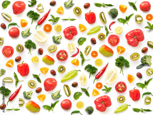 The concept of healthy eating. Pattern composition from vegetables and fruits, top view. Food background, wallpaper. Tomatoes, pepper, lemon, kiwi, basil, parsley isolated on white background. - 185385153