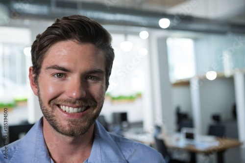 Male executive looking at camera in the office