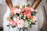 Bride with bouquet, closeup © teksomolika